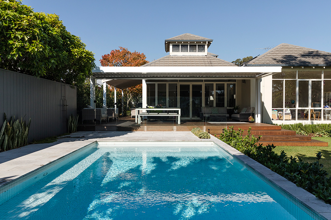 a contemporary landscape design including a tiled concrete pool